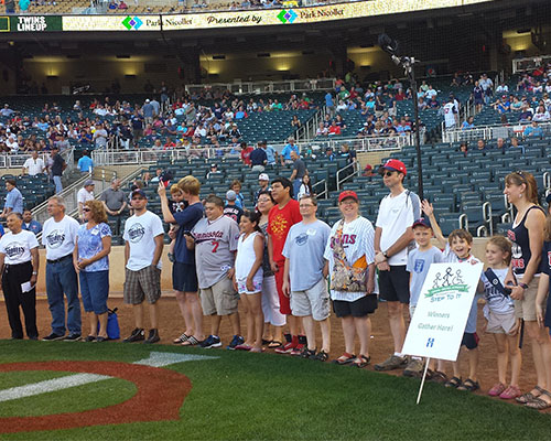 Kids receiving awards at a Twins game